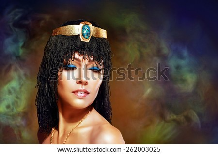 Beautiful egyptian woman bronze portrait over grunge - stock photo