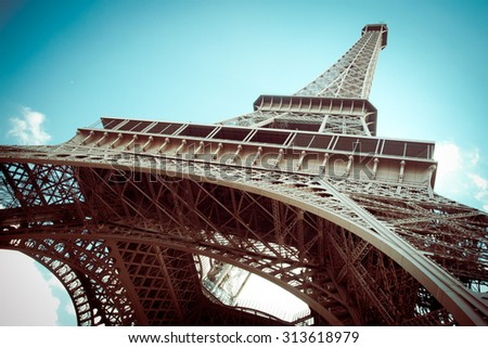 Beautiful Eiffel Tower in Paris France with retro tone filter effect - stock photo