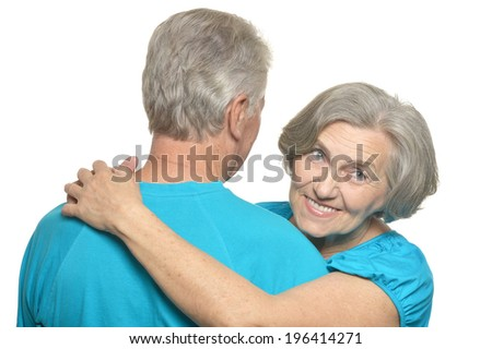 Beautiful elderly couple spending time together on a white background
