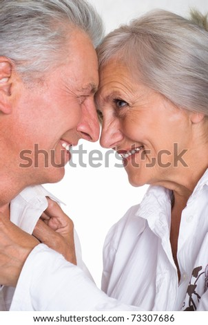 beautiful elderly couple together on a white background