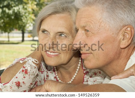 Beautiful elderly couple went to the nature on weekends