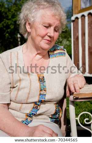 beautiful elderly woman reading a book