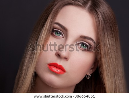 Beautiful elegance blonde hair woman, has sensuality face, green contact lenses in eyes, sexy pink lips,. Portrait studio. Black background. Ombre dye. - stock photo