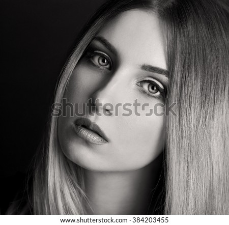 Beautiful elegance blonde hair woman, has sensuality face, serious eyes, sexy lips. Portrait studio. Black and white. Ombre dye.