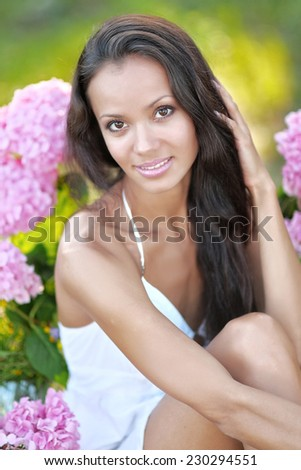beautiful elegant brunette girl on the nature - stock photo