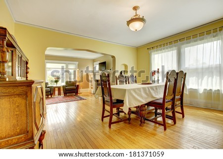 Beautiful elegant dining room with antique carved wood table set and cabinet - stock photo