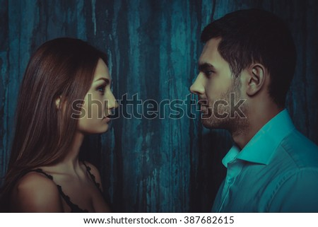 Beautiful elegant girl  and handsome man looking at each other - stock photo