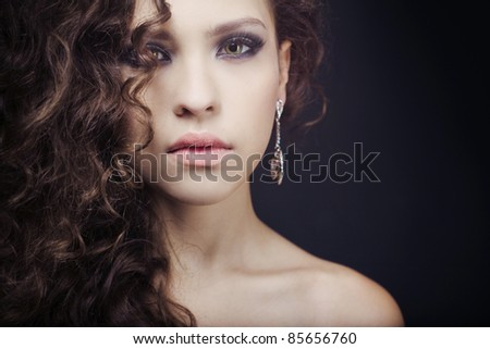 beautiful elegant girl with an evening make-up wearing jewelry - stock photo