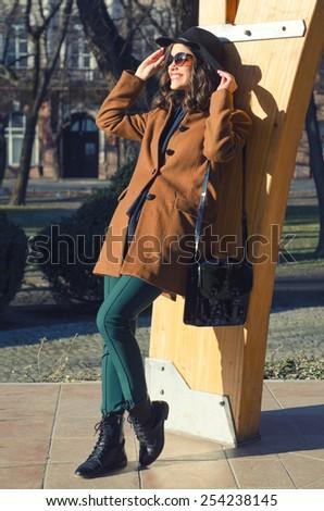 Beautiful elegant lady enjoying sunny spring day in the park. - stock photo