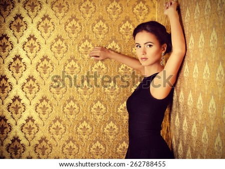 Beautiful elegant lady in vintage interior. Fashion shot. - stock photo