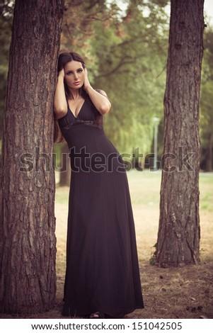 beautiful elegant mature woman  in the wood - stock photo