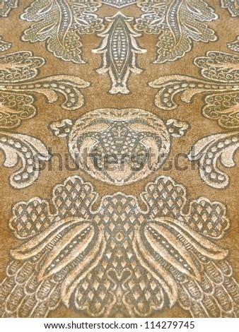 Beautiful, elegant paisley in deep autumn colors, red, orange, sepia, brown. - stock photo