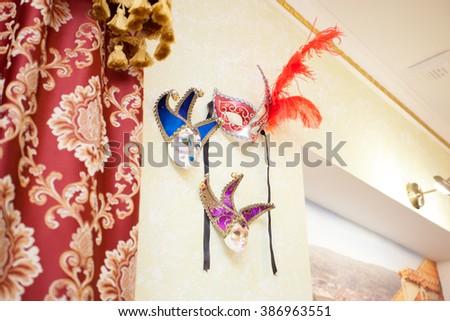 Beautiful elegant venetian mask on a wall  - stock photo
