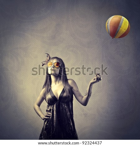 Beautiful elegant woman holding a balloon