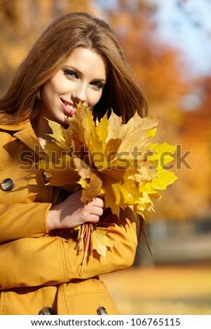 Beautiful elegant woman in a autumn park - stock photo
