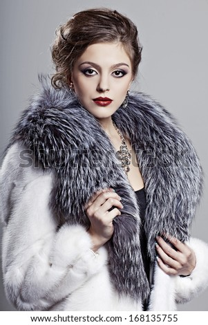 Beautiful elegant woman in a fur coat - stock photo