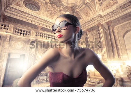 Beautiful elegant woman in a luxury hotel - stock photo