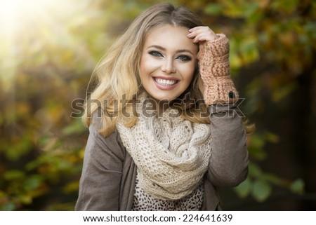 Beautiful elegant woman  in a park in autumn - stock photo