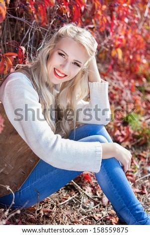 Beautiful elegant woman in autumn park