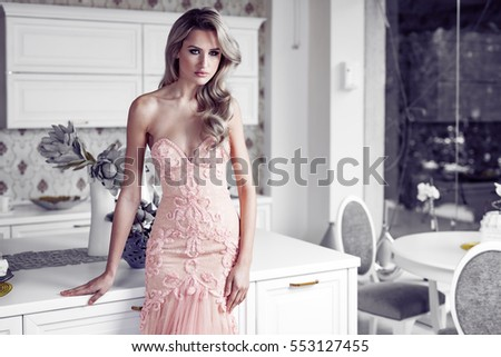 Beautiful elegant woman in modern home