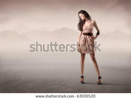 Beautiful elegant woman in the desert