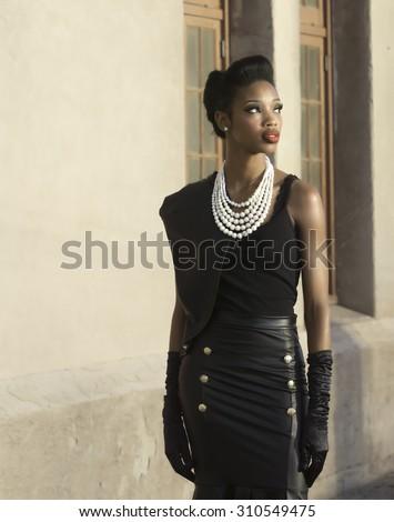 Beautiful elegant woman in vintage attire turning face - stock photo