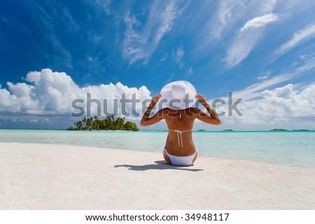 beautiful elegant woman in white on tropical beach - stock photo