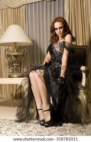beautiful elegant woman, long black film noir gown. luxurious background.