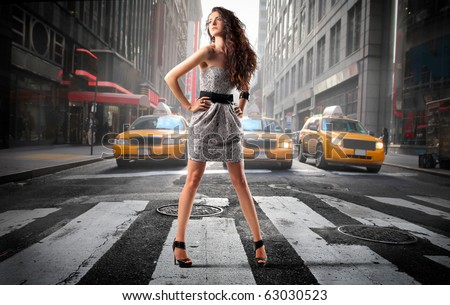 Beautiful elegant woman on a city street - stock photo