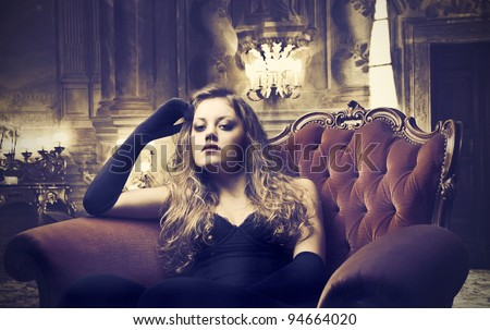 Beautiful elegant woman sitting in a luxury hotel lounge