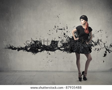 Beautiful elegant woman with artistic dress - stock photo