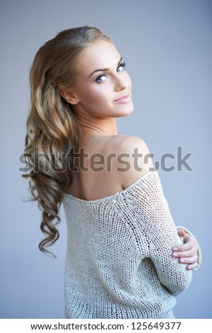https://thumb7.shutterstock.com/display_pic_with_logo/61004/125649377/stock-photo-beautiful-elegant-woman-with-long-curly-blonde-hair-wearing-a-stylish-off-the-shoulder-top-looking-125649377.jpg