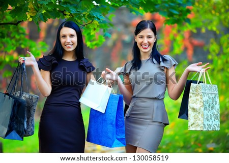 beautiful elegant women after shopping, colorful outdoors