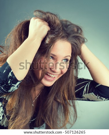 beautiful emotional brunette girl  on  gray background