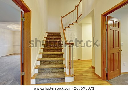 Beautiful entrance to house with stairs and hardwood floor.