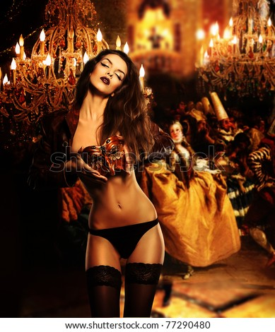 beautiful erotic woman with mask on venetian masquerade ball - stock photo