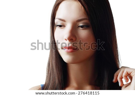 Beautiful ethnic woman. Beauty portrait of mixed race Asian Caucasian female beauty model isolated on white background. Closeup of woman with long dark hair. - stock photo