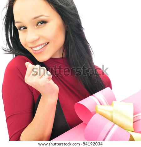 Beautiful European young woman holding her huge gift against white background - stock photo