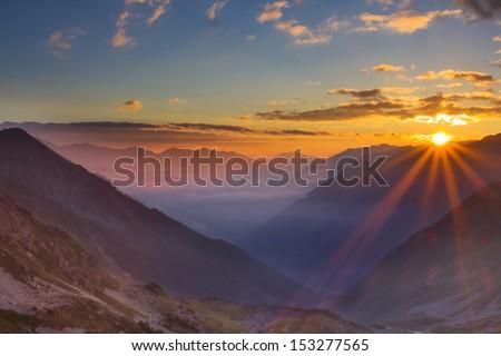 beautiful evening mountain scene - stock photo