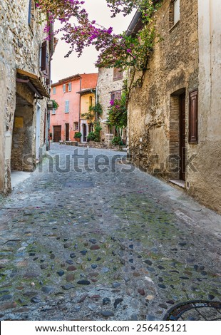 Beautiful evening street of the old town - stock photo