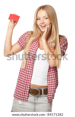 Beautiful excited blond female in casual holding blank card over white background - stock photo