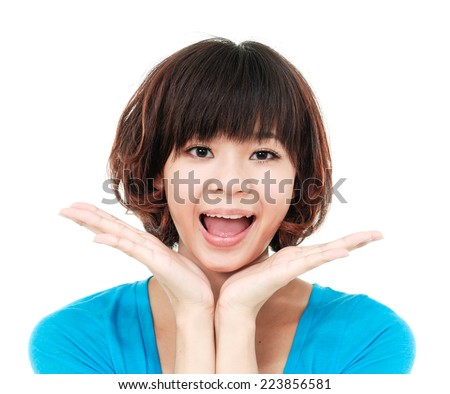 beautiful excited teenage girl with hands up near her face.