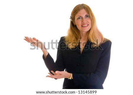 Beautiful executive business woman in navy blue business suit pointing and gesturing toward her right - stock photo