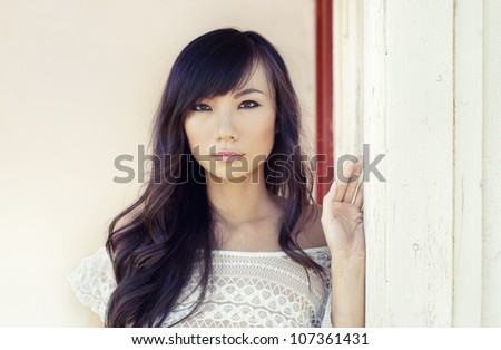 Beautiful exotic Asian young woman - stock photo