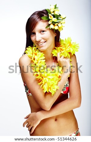 Beautiful exotic girl with Hawaiian accessories - stock photo