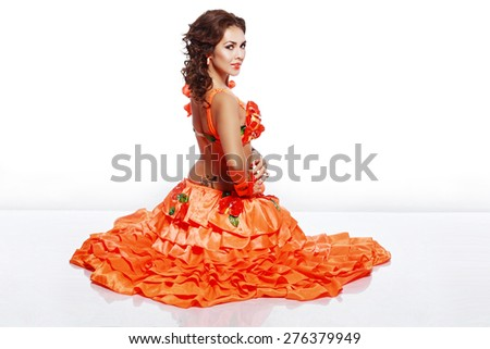 Beautiful exotic girl with Hawaiian accessories dress sitting on the floor