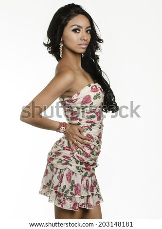 Beautiful exotic mixed race young woman isolated against white background - stock photo