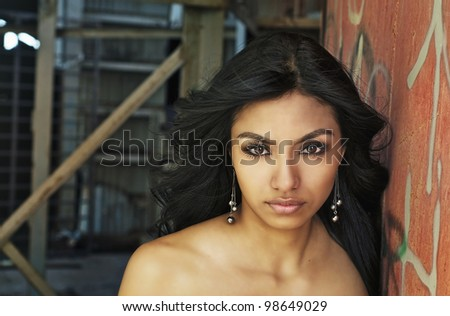 Beautiful exotic mysterious young woman - stock photo