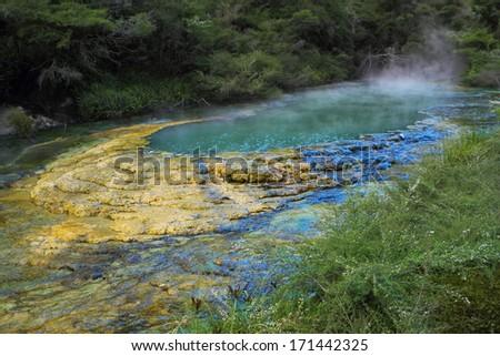 Beautiful exotic turquoise geothermal lake in Rotorua, New Zealand - stock photo