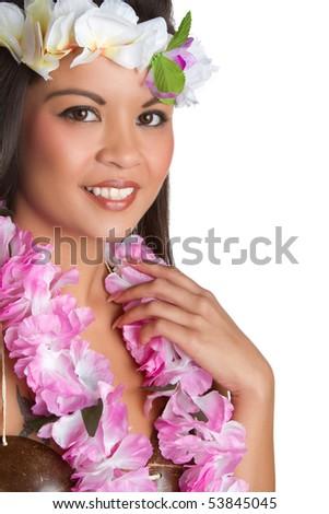 Beautiful exotic woman wearing tropical lei - stock photo